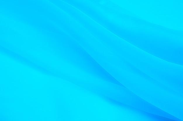 Tecido de seda, organza é azul claro.