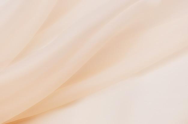 Tecido de seda, organza é bege claro.