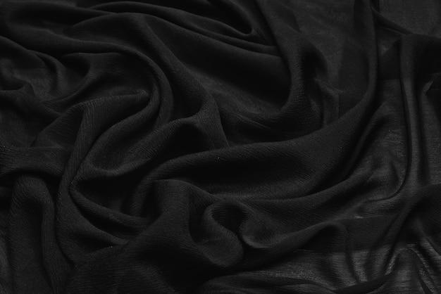 Tecido de seda preto ondulado
