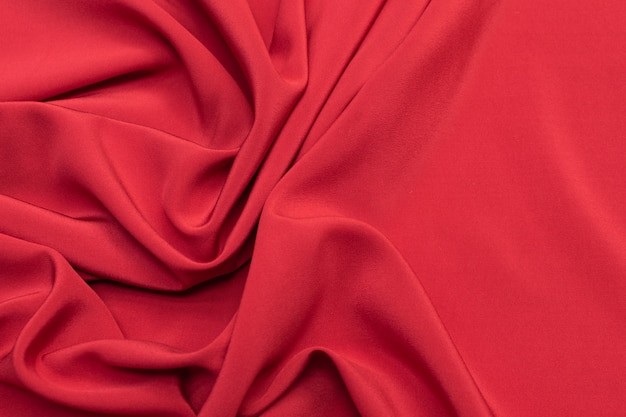 Tecido de seda sarja cereja no layout artístico. textura, plano de fundo, padrão.