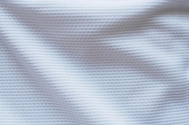 Tecido de tecido de camisa de futebol branco, textura esportiva, plano de fundo, close-up