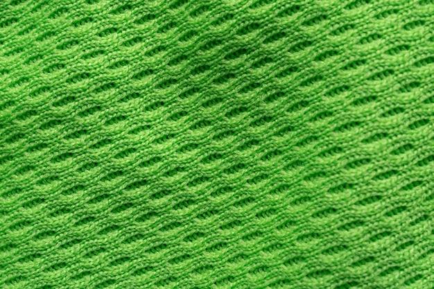 Tecido de tecido esportivo verde camisa de futebol textura de jérsei close-up