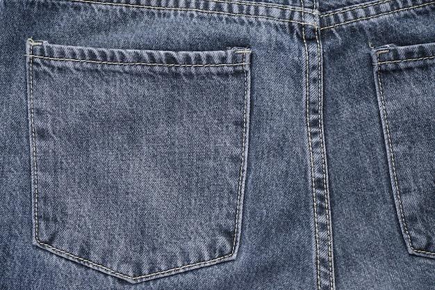 Tecido denim texturizado com costura de design moderno. foco seletivo. fundo de jeans clássico.