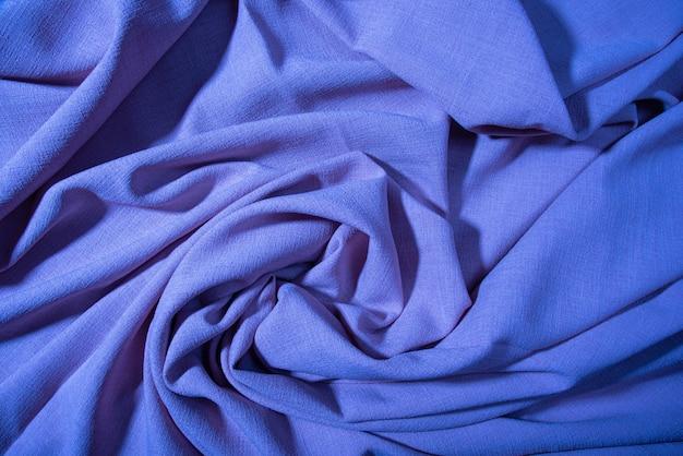 Tecido, detalhes de tecido dispostos aleatoriamente na superfície