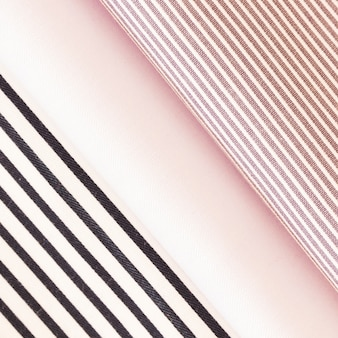 Tecido dobrado preto e rosa listras
