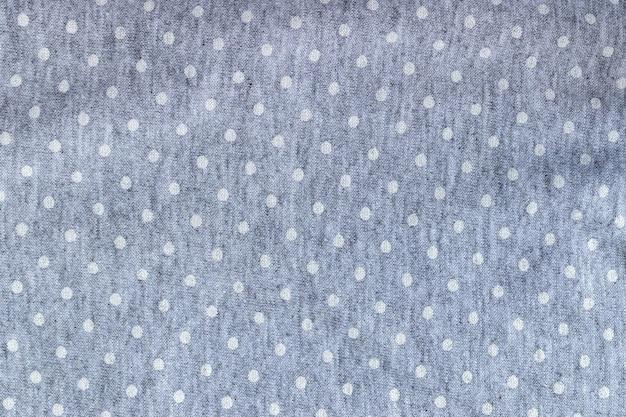Tecido jérsei de algodão cinza suave com bolinhas brancas