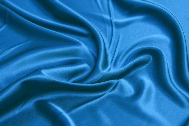 Tecido liso e elegante de seda verde água da maré (cetim) como pano de fundo para o design