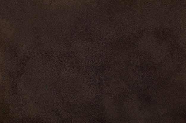 Tecido marrom escuro de camurça fosco closeup