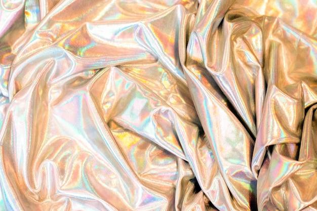 Tecido reflexivo de fundo holográfico textura multicolorido iridescente
