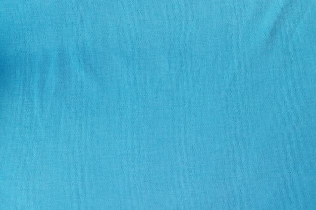 Tecido tecido de malha de algodão. fundo azul têxtil