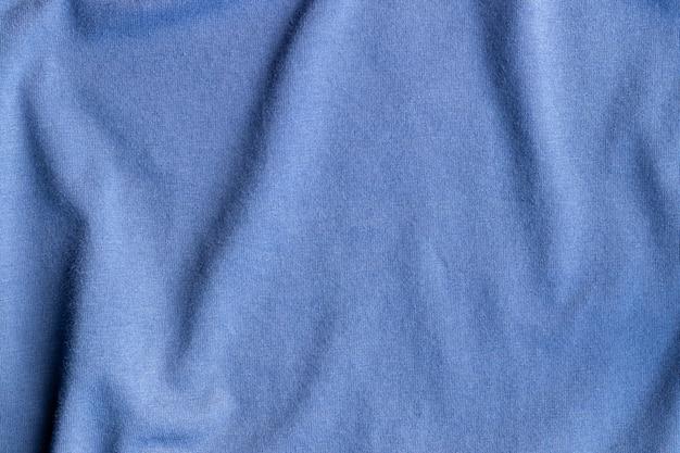 Tecido tecido jérsei de algodão. fundo azul amassado de tecido