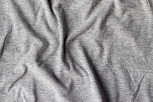 Tecido tecido jérsei de algodão. fundo de tecido cinza amassado