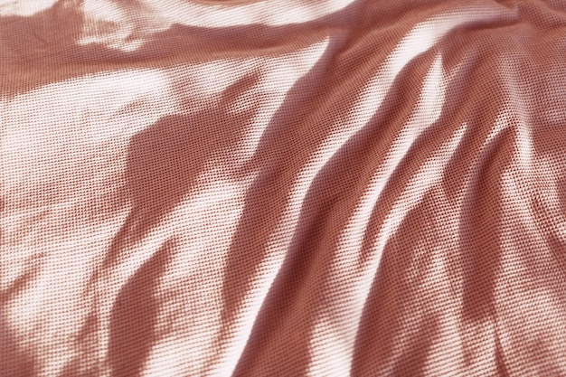 Tecido turquesa com um cochilo plissado.