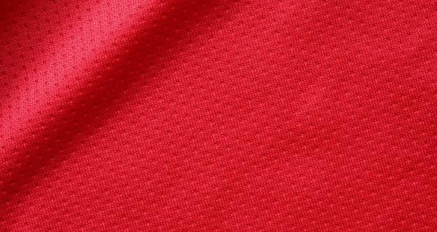 Tecido vermelho para roupas esportivas, camisa de futebol, textura, close-up