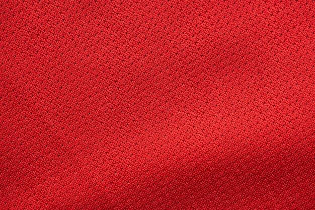 Tecido vermelho para roupas esportivas com textura de camisa de futebol close-up