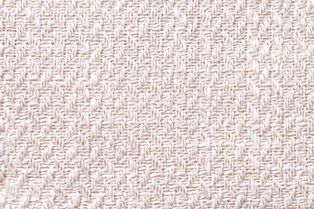 Tecido vintage rosa com textura de tecido closeup. fundo branco macro têxtil