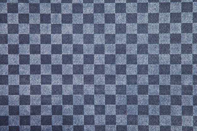 Tecido xadrez azul e cinza close-up. fundo geométrico de padrão quadrado. espaço de direitos autorais para site ou logotipo