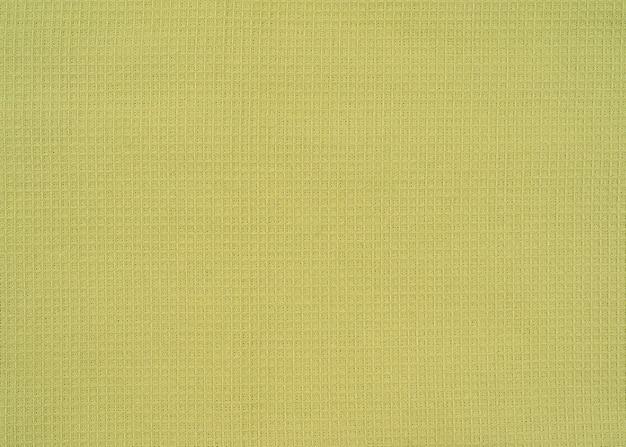 Tecidos de textura de linho verde claro de vista superior, estrutura de waffle
