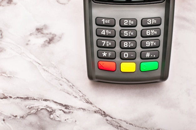 Teclado cinza do terminal de pagamento sem contato
