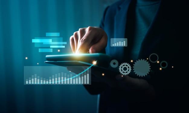 Tecnologia de ai de inteligência artificial financeira de negócios, mão tocando o tablet com gráficos e gráficos financeiros.
