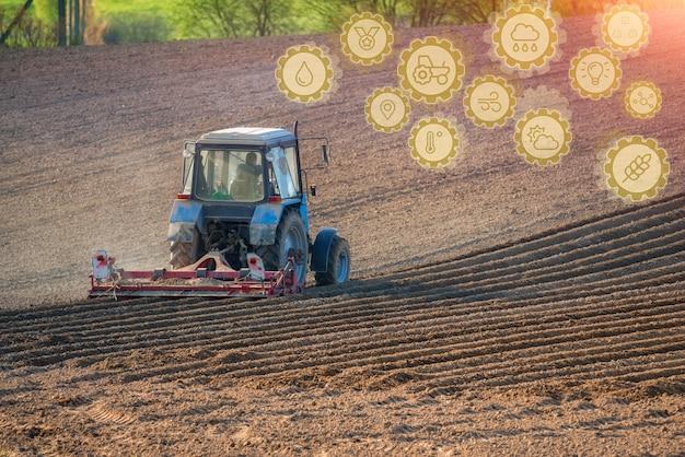Tecnologia inovadora de pictogramas e um agricultor em um trator. startups agrícolas, melhorias na indústria agrícola. inovação e desenvolvimento da indústria agrícola.