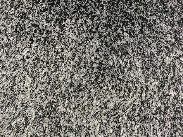 Tela abstrata de superfície closeup no tapete de tecido preto no chão da casa textura de fundo