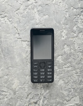 Telefone botão obsoleto com tela em branco