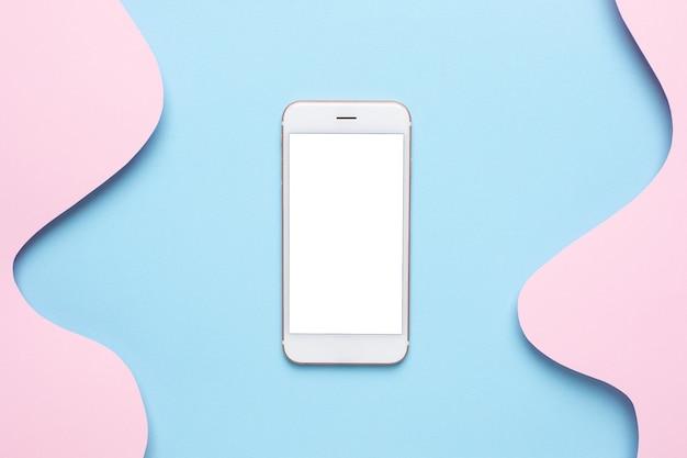 Telefone celular e papel abstrato cortam arte de ondas azuis em rosa