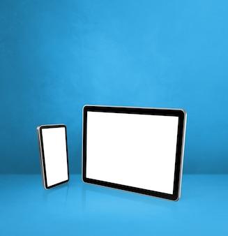 Telefone celular e tablet digital em uma mesa de escritório azul