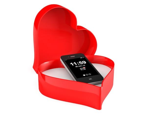 Telefone celular em uma caixa do dia dos namorados com o coração em um fundo branco