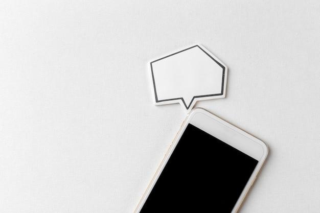 Telefone com bolha do discurso em branco