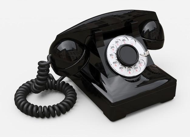 Telefone de discagem preto velho em um fundo branco