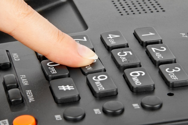 Telefone e dedo