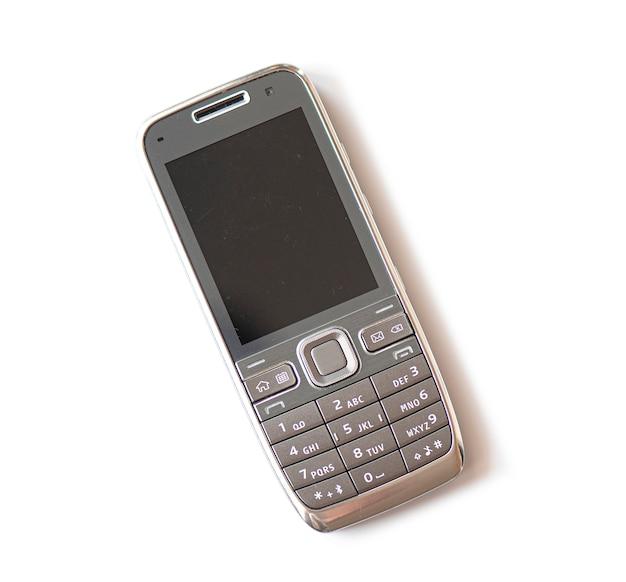 Telefone móvel plástico usado velho isolado