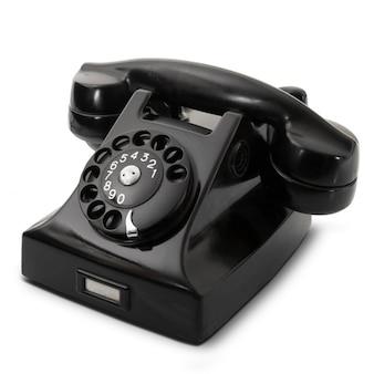 Telefone obsoleto no fundo branco