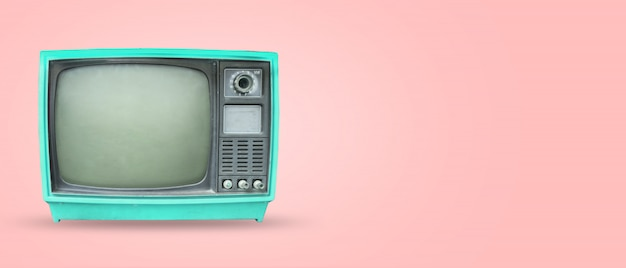 Televisão de etro - tv vintage velho no fundo de cor pastel