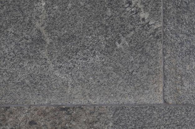 Telha de granito cinza escuro close-up