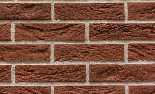 Telha em forma de fundo de textura de parede de pedra de tijolos Foto Premium