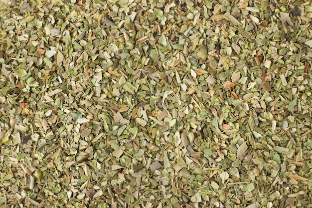 Tempero de orégano seco como pano de fundo, textura natural tempero