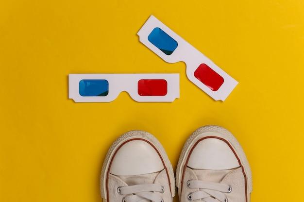 Tênis da velha escola e óculos 3d anáglifos em um amarelo