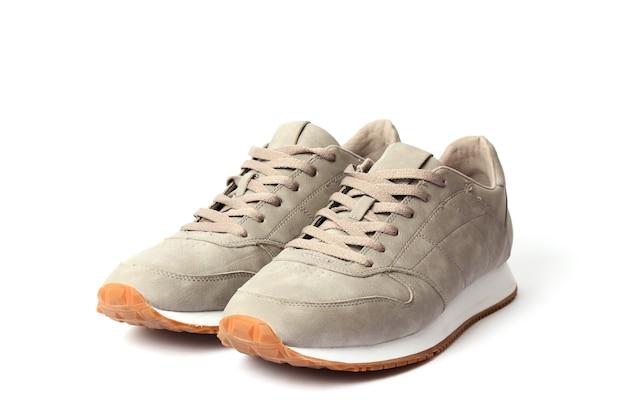 Tênis masculino isolado em calçado masculino branco