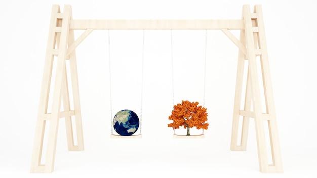 Terra e árvore de bordo em um balanço de madeira - dia mundial do ambiente
