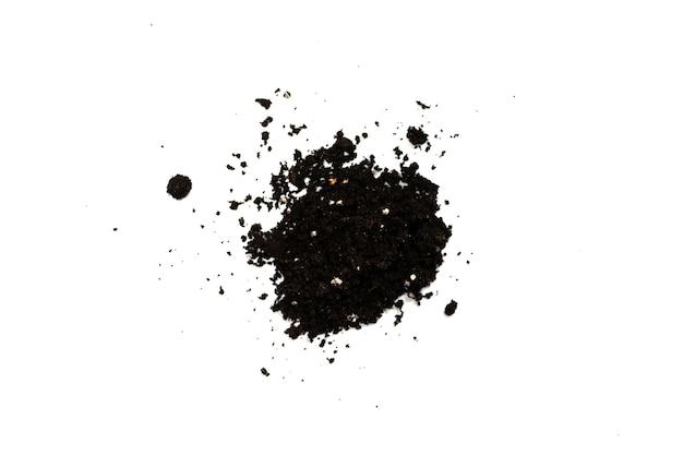 Terra preta para planta isolada no fundo branco. padrão de solo.