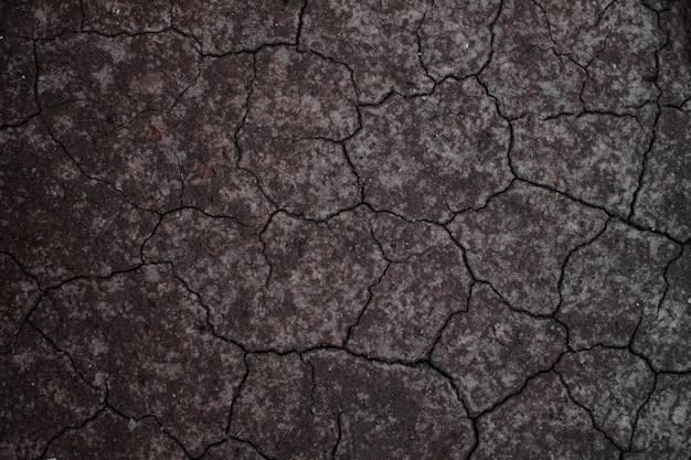 Terra seca ou solo seco. fundo de chão rachado.