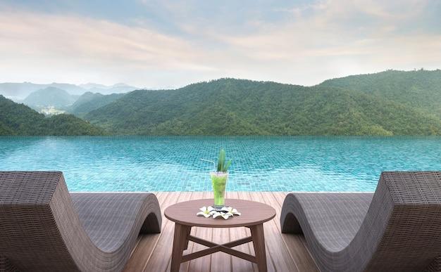 Terraço da piscina com vista para a montanha. renderização em 3d. mobiliado com vime e móveis de madeira
