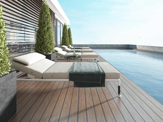 Terraço junto à piscina com espreguiçadeiras perto da casa moderna. renderização 3d