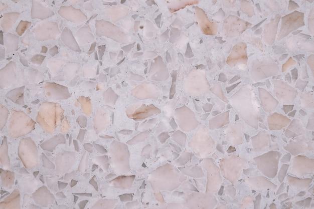 Terrazzo lustrou o teste padrão do assoalho e da parede de pedra e coloriu a pedra do mármore e do granito, material para a textura do fundo da decoração.