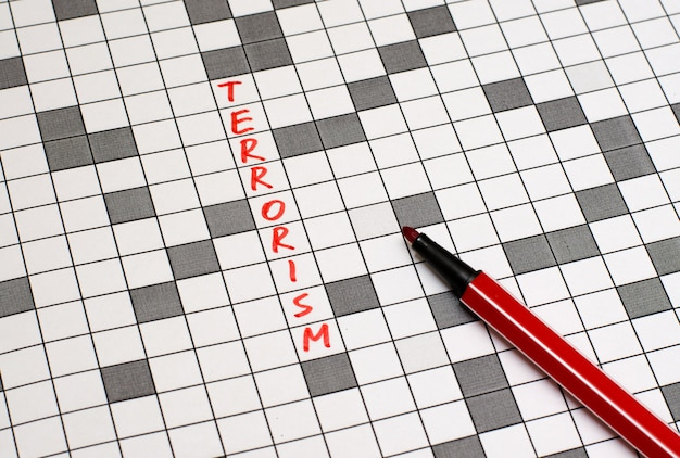 Terrorismo. texto em palavras cruzadas. letras vermelhas