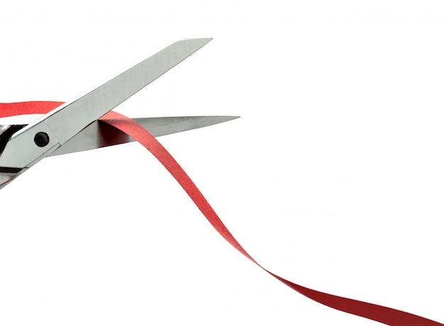 Tesoura, corte uma fita vermelha. traçado de recorte