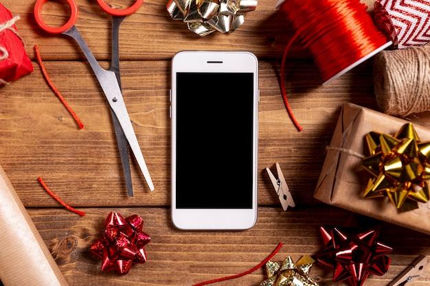 Tesoura de telefone e presentes de natal